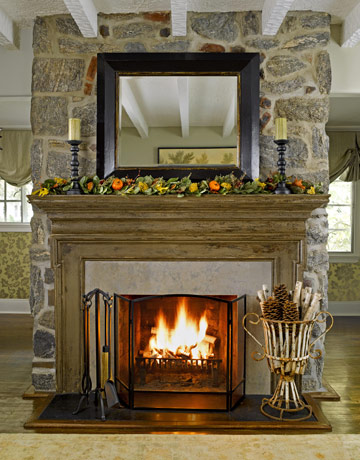 A Fall wreath is a simple and quick addition to your Fall mantel. Paired with a rustic urn filled with firewood, the effect is undeniably autumnal.  Source