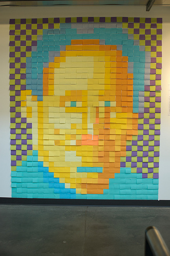 At a writing conference, a man's Mao-esque portrait was made from Post-Its on the wall. Source: Flickr User djwudi