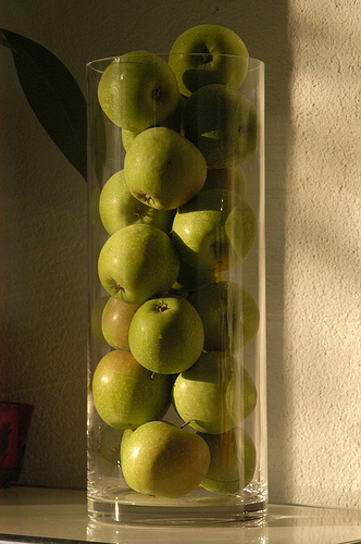 For an easy way to showcase a weekend spent at the pick-your-own apple farm, stack them in a tall vase. Source