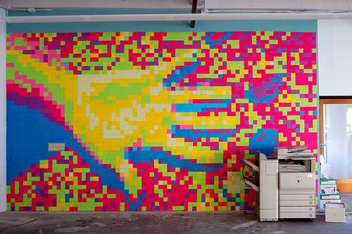 At Yahoo's Brickhouse office in San Francisco, a giant pixelated hand was created from Post-Its. Source: Flickr User kev/null