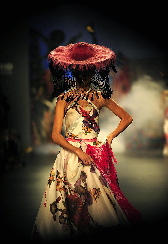 Montesinos's floral silk dress is truly beautiful, but the pink headdress is the real showstopper.