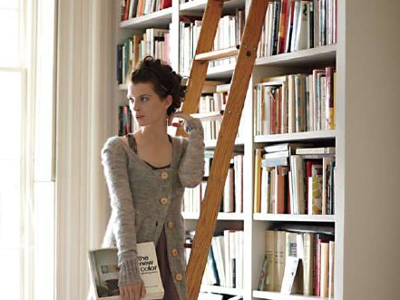 If you stack your books high, consider adding a library ladder to help you access your collection.