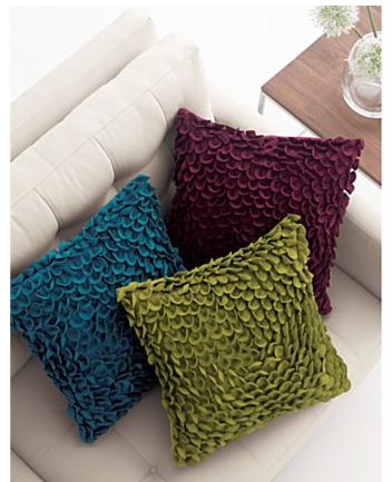 Pick up some vibrant, jewel-toned pillows for Fall. I love the laser-cut circles on these Carmen Pillows ($49.95 each).