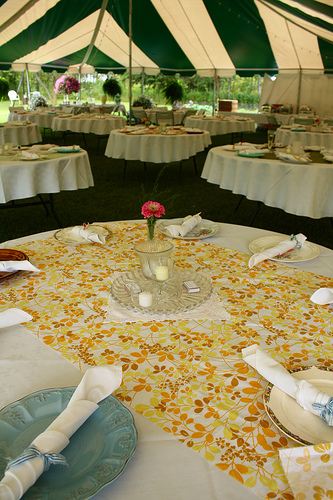 Jamie layered vintage linens and doilies in varying patterns on all of the reception tables.