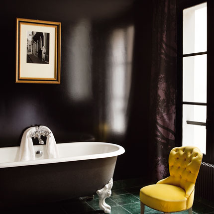 A pop of bright yellow against a glossy black background has real wow factor. But it's not headache-inducing either. To keep it from looking too monochrome, add another accent color like deep purple. Source