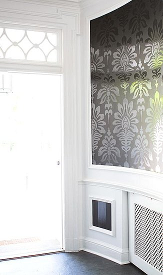 An oversize pattern on this wallpaper makes the space dramatic, while the white walls and details lend the space an airy feel. I love the different patterns in the glasswork and gridding, which doesn't compete with the wallpaper pattern so much as complement it. 