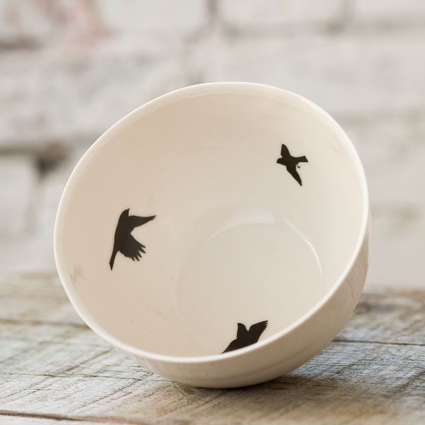 This Bird Bowl ($58) from Coe & Waito is a porcelain slip cast vessel embellished with blackbird images. It's great for displaying your more sophisticated Halloween candy.