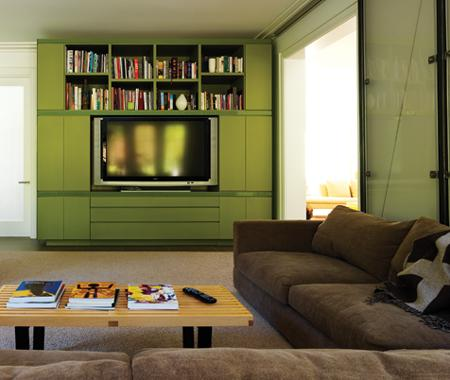 A built-in cabinet is the perfect spot for displaying a flat screen, while open shelving provides easy access to books, DVDs, and other must-have items for your living space. Source