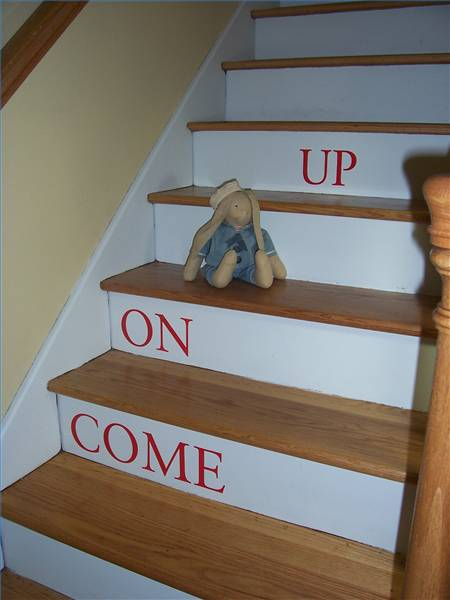 Or, you could paint words on your stairs  instead, inviting friends and family members to explore your home.