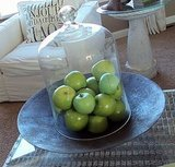 Display pretty fruit under a cloche. It's at least as pretty as a sculpture, don't you think? Source