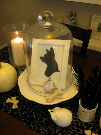 Young House Love created a fun Halloween display with this glass cloche. Find other ways to decorate for Halloween here.