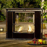 The Wesley Indoor/Outdoor Portable Fireplace ($129) from Overstock is made of metal and glass and burns up to two cans of gel fuel.