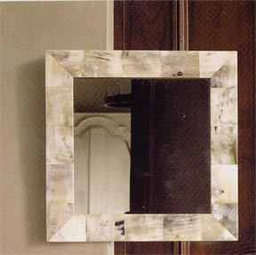 Choose a mirror with a capiz, horn, or wooden frame, such as this Roost Horn Mirror  ($300).