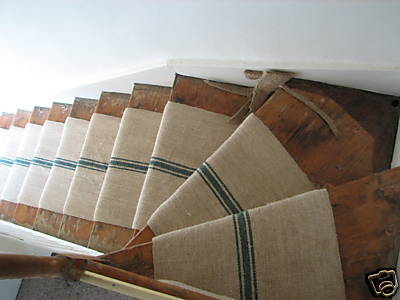 Antique hemp, such as the type used in flour sacks, adds rustic charm to this wooden staircase.  Source