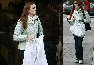 Marcia Cross Grabs an Apple