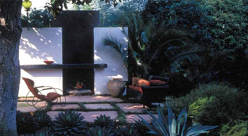 Outdoor lounge areas encourage a relaxed mood in this patio.