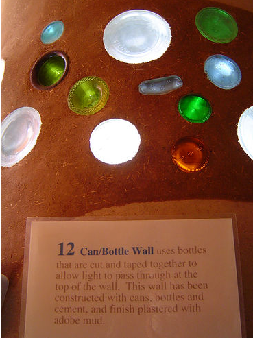 Recycled bottles provide unexpected stained glass elements in the wall.Source