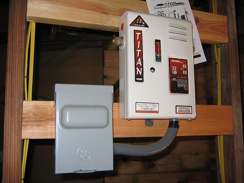 A tankless water heater, which only heats water on demand, saves energy and money.