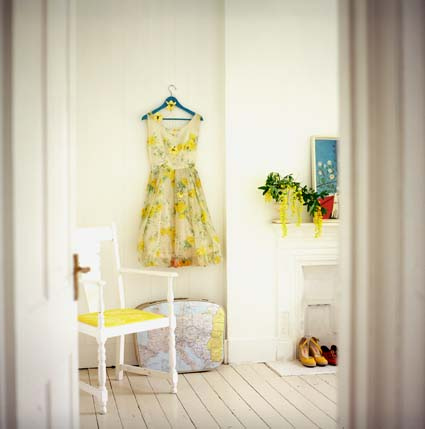 Here, in a photo by interiors photographer Debi Treloar, a yellow sundress ties together other accents in the room, such as upholstery, flowers, and shoes. Source