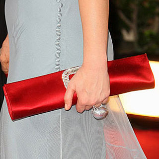 Guess the Golden Globe Star by Her Cunning Clutch!