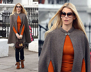 Claudia Schiffer in London Wearing a Cape and Moccasins