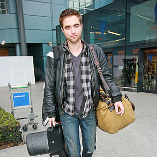 Robert Pattinson Arrives at Heathrow