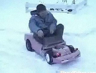 Guy Does Donuts in the Snow With Malibu Barbie Car