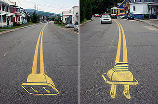 Street Artist Peter Gibson Paints Electrical Plugs on the Road