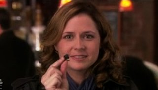 Jim and Pam From The Office Use The World's Tiniest Bluetooth Earpiece