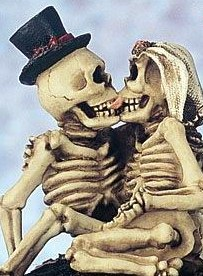 I understand a Halloween inspired wedding, and I'll even go as far as to say I can see certain folks who might want a skeleton cake topper. However, a cake topper with french kissing skeletons ($75), that I just can't understand.