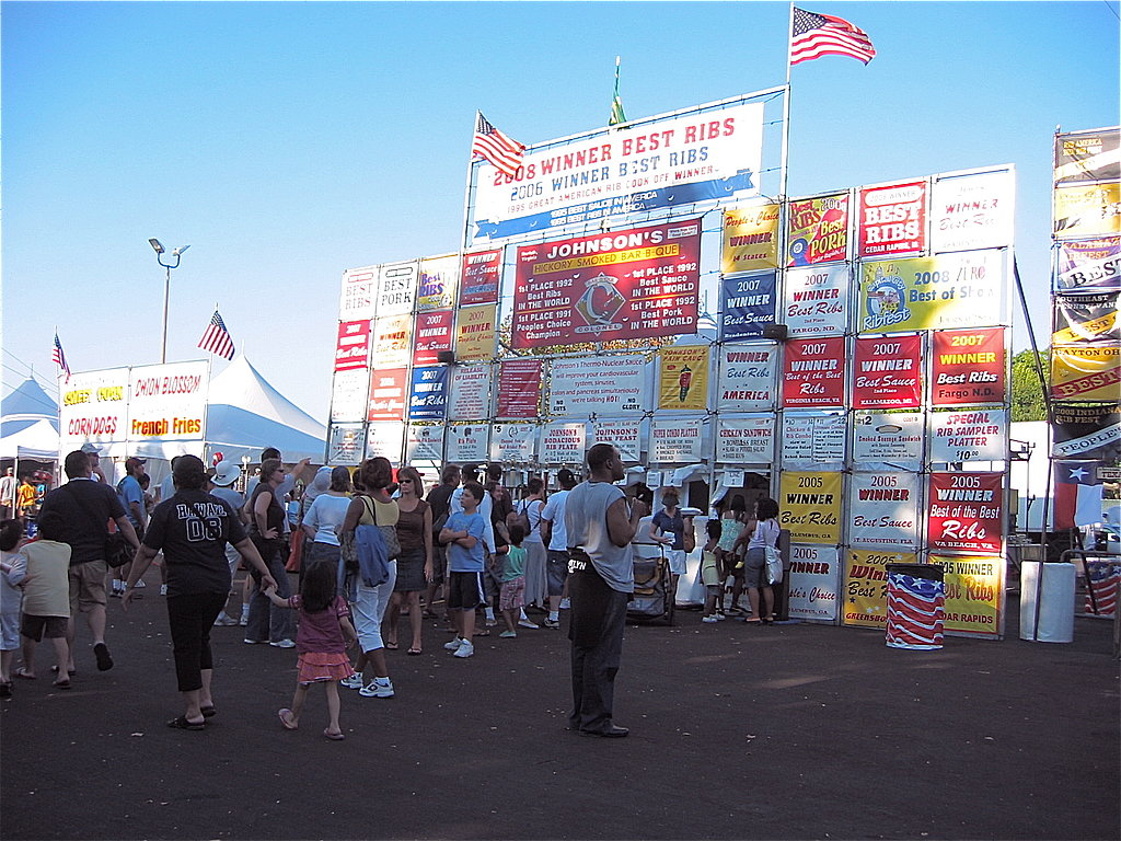 Barbecue cookoffs are usually composed of barbecue companies that travel around the country, offering regional takes on barbecue — in particular, ribs.  The bigger the signage at a rib stand, the more the awards, which meant a longer line of hungry festival goers.