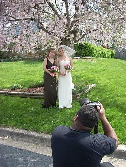 Me with one of my bridesmaids, and our photographer.