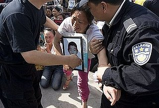 Chinese Police Drag Grieving Parents From Protest
