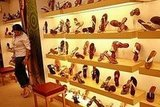 A true sign of progress — a woman shops for shoes!!