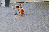 Gabrielle Steenblock, 8, walks across a flooded street near downtown Cedar Rapids.