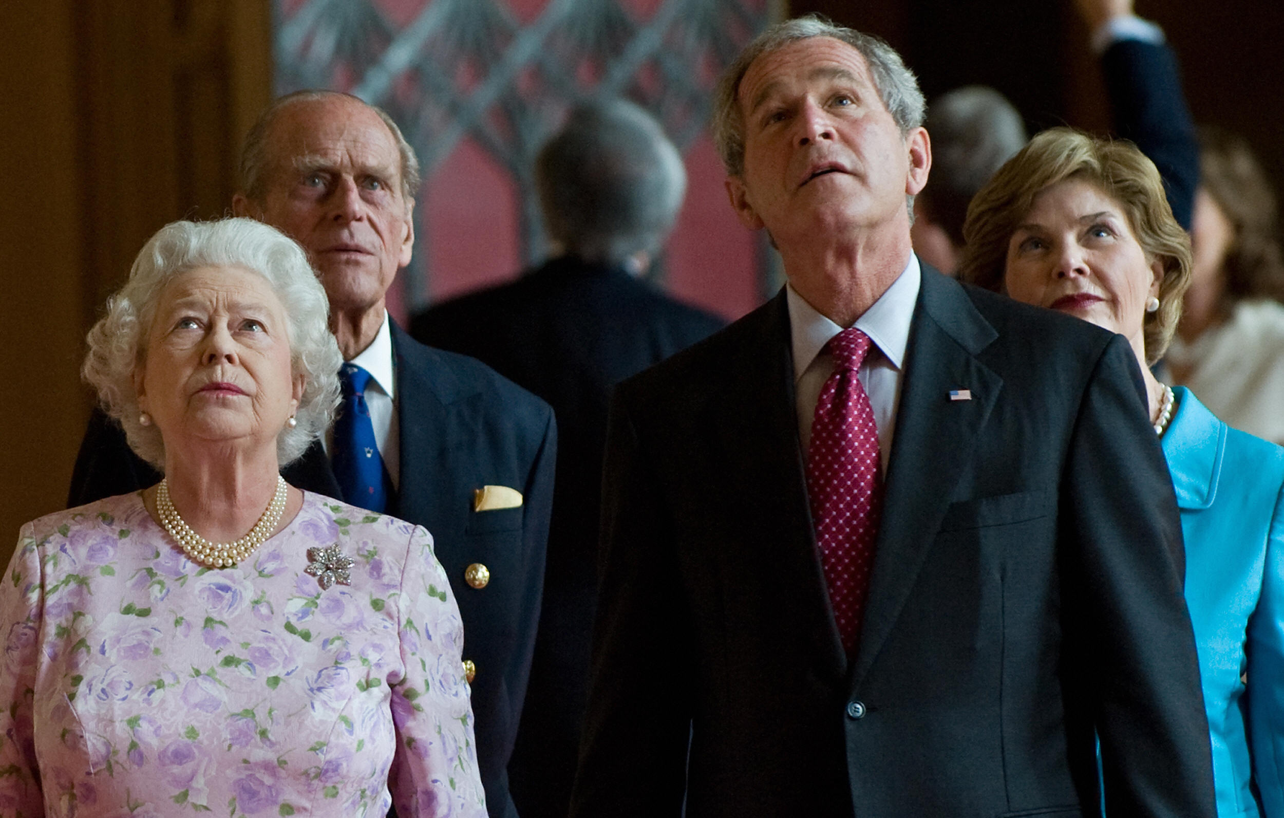 Britain's Queen Elizabeth II (L) and Prince Philip, Duke of Edinburgh give a tour of St George's Hall at Windsor Castle.