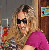 Photo of Sarah Jessica Parker with blonde Straight Hair and dark roots