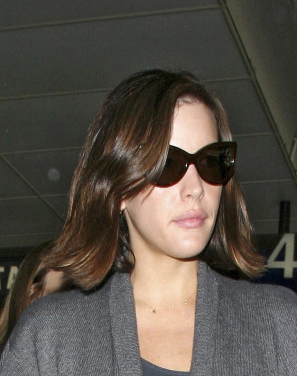 Photo of Liv Tyler at LA Airport With Shiny Retro Waves Hairstyle. Love or Hate Her Look