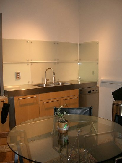 Opposite the Dacor fridge is the sink. We placed a round glass table in the middle to bring the room together.