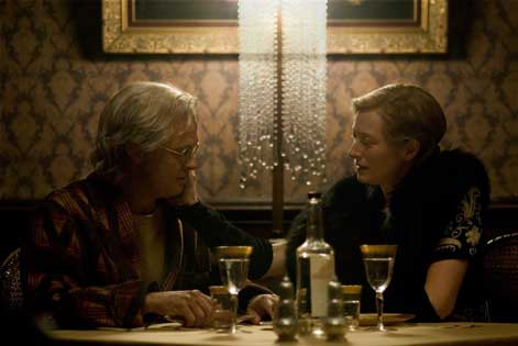 Benjamin and Elizabeth (Tilda Swinton) share an intimate moment. What really caught my attention though was the cascading crystal chandlier behind them. Try the Masa Chandelier ($996) for a similarly dramatic effect.