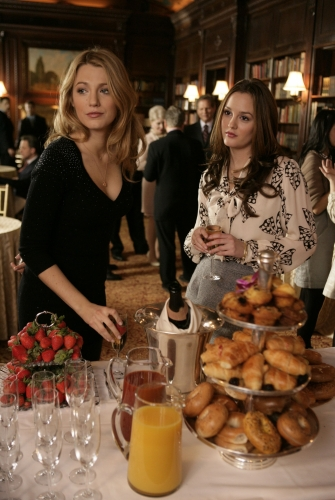 Serena and Blair ignore the veritable mountain of doughnuts displayed on the silver tiered stand.