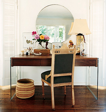A modern-lined desk is accented by quirky and feminine accessories.