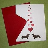 Wiener dogs are the definition of cuteness. Any dog-lovers in your life will adore this Dachsunds in Love Card ($2).