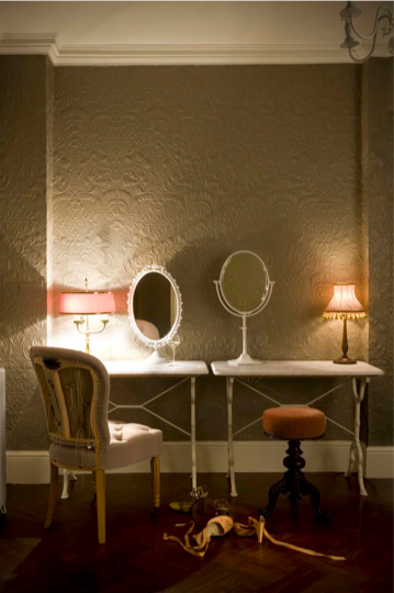 Be revealing. The back on the button-tufted chair in this powder room was left unupholstered. The result is unexpected and a little risqué, but since the room is otherwise reserved, it's genius.