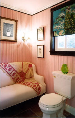 While not absolutely functional (who wants to sit on a sofa while someone's on the toilet?), I love this powder room on a conceptual level. The pink walls, beautiful pieced throw, and green accents are perfect.