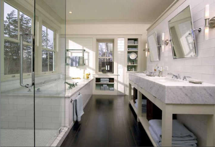 The light tile work in the bathroom gets added drama from the ebony-stained maple flooring.