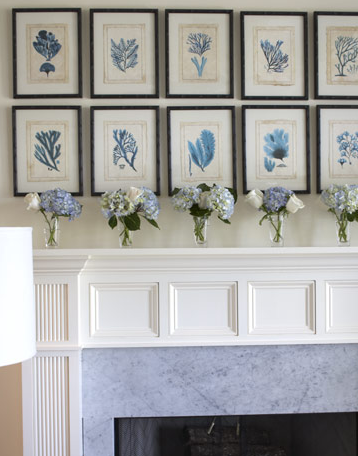 Botanical prints are repeated in multiples across the length of the mantel, and echoed in sentiment with cuttings of blue hydrangeas and white roses.