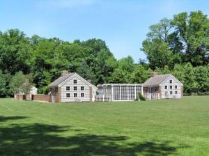 The guest cottages feature a wide expanse of lawn behind them — perfect for a game of croquet.