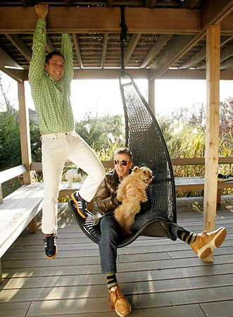 Adler and Doonan hang out on the porch of their three-bedroom, 1,800-square-foot beach cottage.