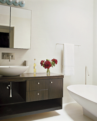 Things are minimal and unfussy in the guest bathroom, where the bowl shape of the sink mimics that of the bath.